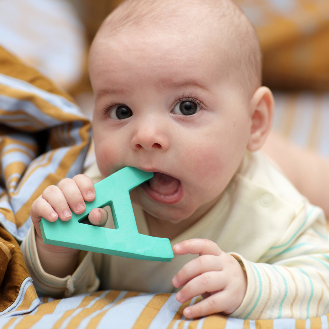 baby with letter A